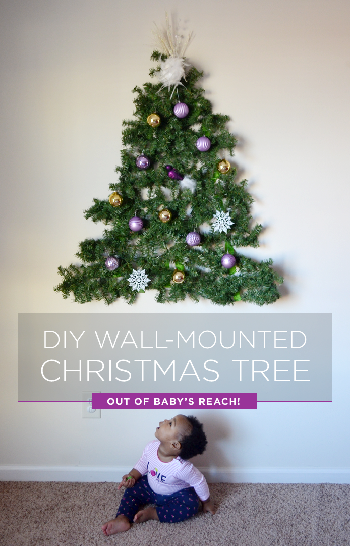 Have a baby put a diy christmas tree on the wall How to hang garland on a christmas tree